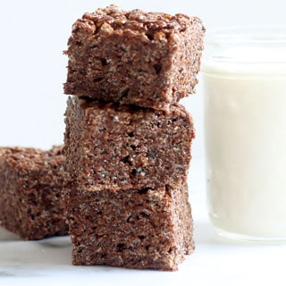 chocolate rice krispie treats image stacked with milk