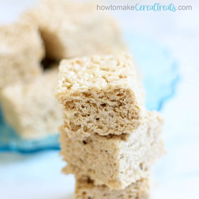overhead image of stacked brown butter Rice krispie treats stacked with title brown butter Rice krispie treats stacked with title brown butter Rice krispie treats stacked with title brown butter Rice krispie treats