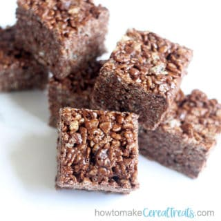 f chocolate rice krispie treats stacked with white background