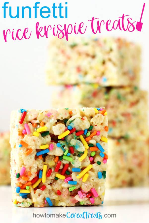 Funfetti Rice Krispie Treats stacked on top of each other are set behind a treat that is standing on it's side so you can see all the rainbow sprinkles on top