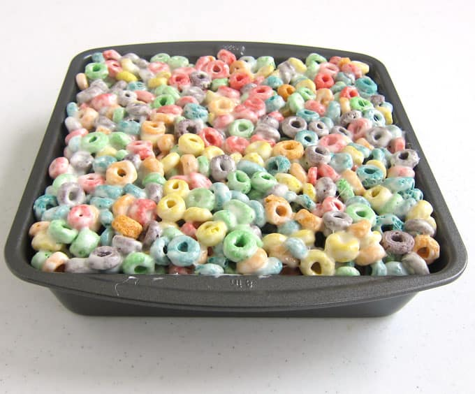 a pan filled with Fruit Loops cereal bars