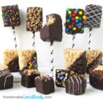 five chocolate dipped rice krispie treat lollipops with 6 chocolate dipped cereal bars, and 4 chocolate dipped rice krispie treat poppers
