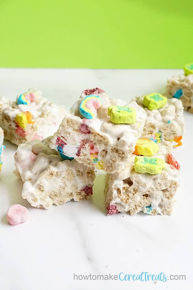 stacked lucky charms treats with green background