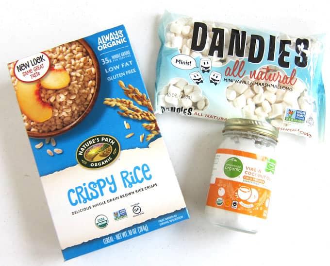 ingredients needed to make vegan rice crispy treats including vegan crispy rice cereal, vegan marshmallows, and coconut oil or vegan butter