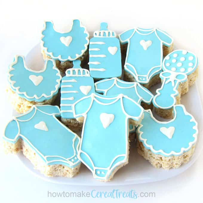 baby shower rice krispie treats including onesies, rattles, baby bottles, and bibs