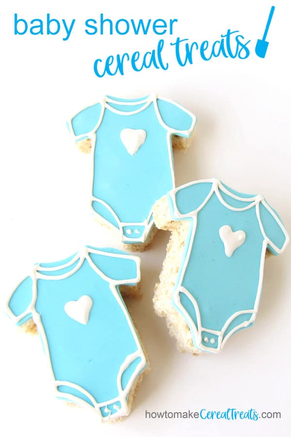 rice krispie treats onesies decorated with light blue modeling chocolate and white chocolate hearts for a baby shower