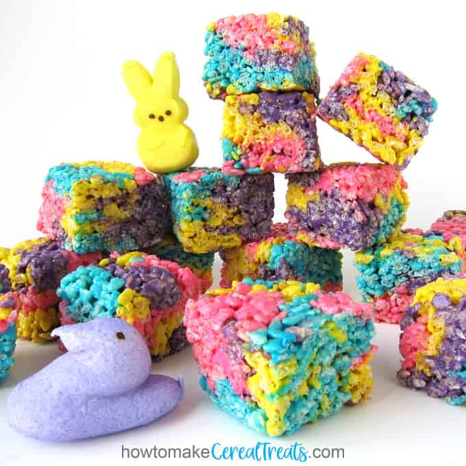 Marshmallow Peeps melted with butter and blended with rice crispy cereal makes colorful cereal treats.