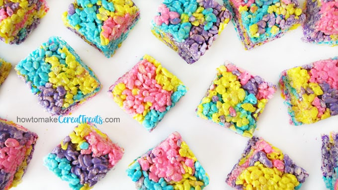 Rainbow colored Rice Krispie Treats made using Peeps make fun no-bake desserts for Easter.