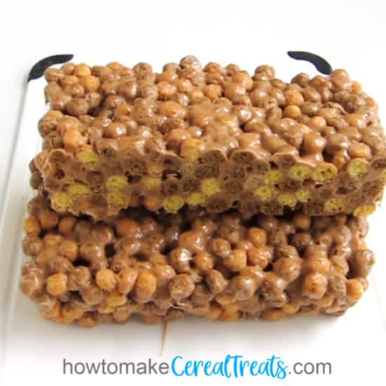 cut a tray of Reese's Puffs Cereal Bars in half to show the cereal pieces cut in half