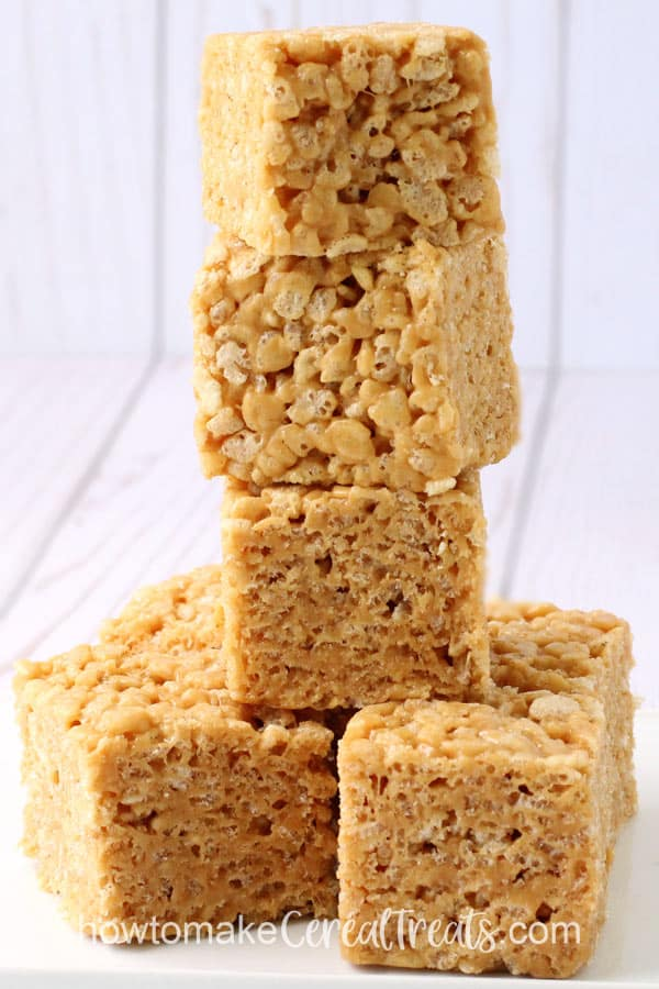 a tall stack of peanut butter butterscotch rice Krispie treats