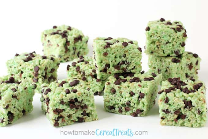 Mint chocolate chip rice krispie treat squares on a white background