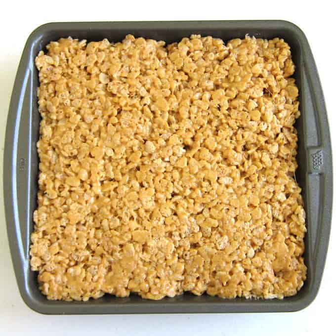 8-inch pan filled with butterscotch and peanut butter rice crispy treats