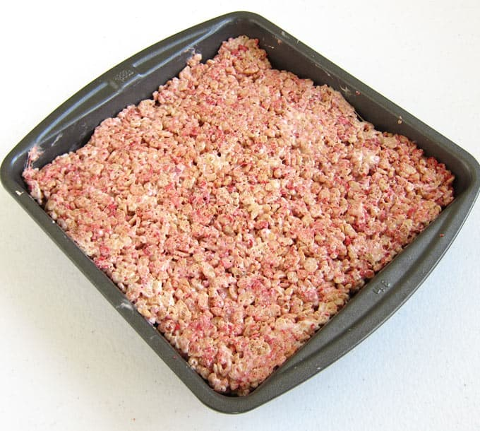 8-inch pan filled with strawberry rice krispie treats