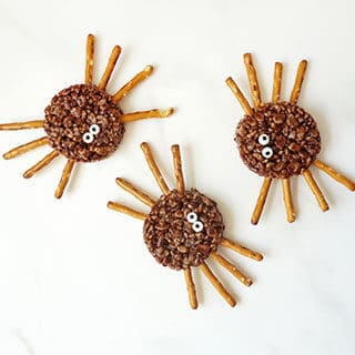 HALLOWEEN RICE KRISPIE TREAT SPIDERS -- Turn rich, delicious chocolate cereal treats into scary spiders for Halloween.