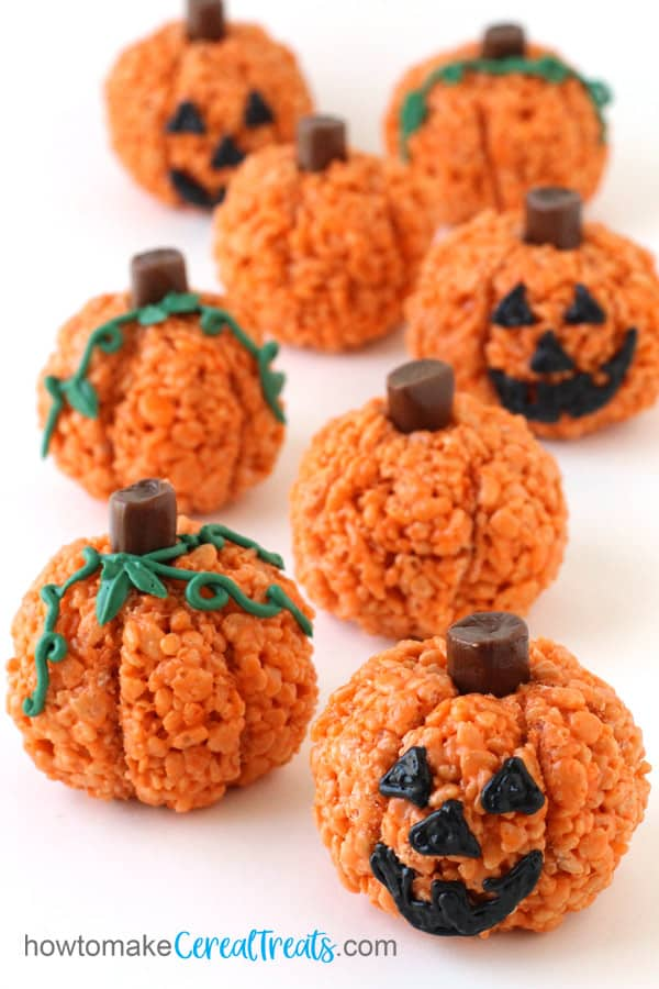 Halloween Rice Krispie Treat Pumpkins and Jack-O-Lanterns with Tootsie Roll Stems and frosting faces and leaves