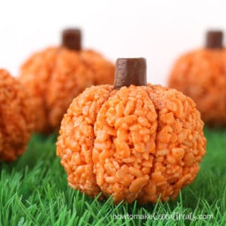 orange rice krispie treat pumpkins arranged on green grass