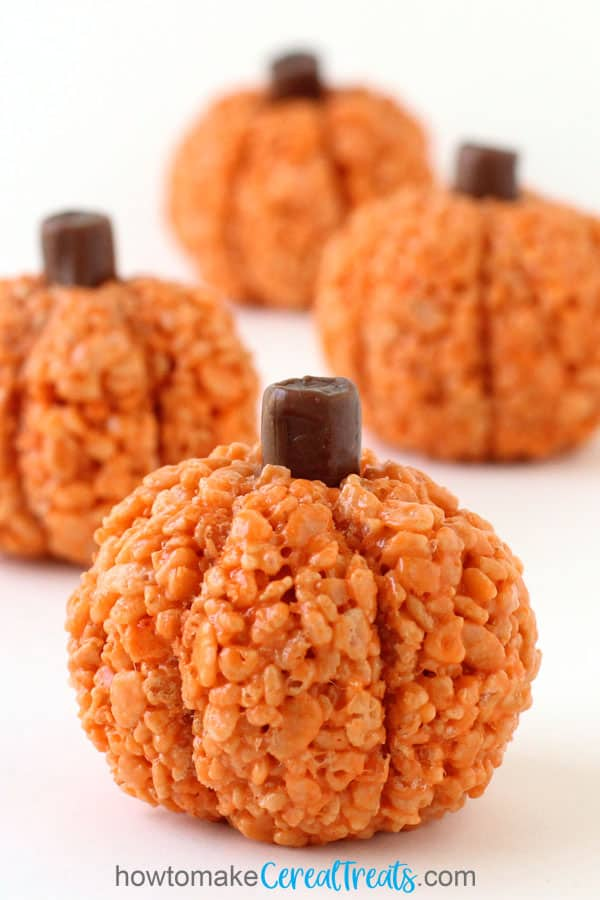 Realistic pumpkin-shaped rice crispy treats with Tootsie Roll stumps