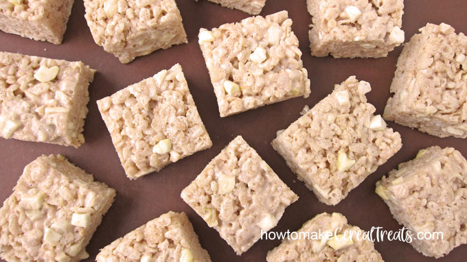 square apple cinnamon rice krispie treats on brown cutting board