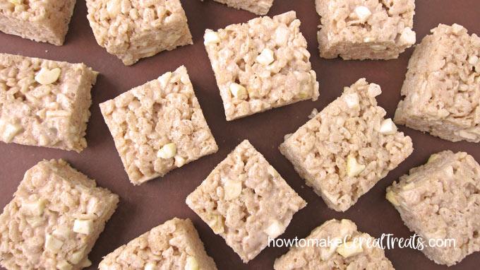 square apple cinnamon rice krispie treats on brown cutting board