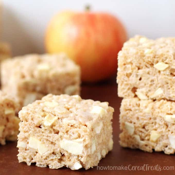 Cinnamon Apple Rice Crispy Treats loaded with bits of dried apple rings and crushed freeze-dried apples.