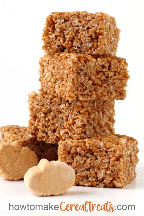 Pumpkin Spice Rice Krispie Treats stacked up in front of Kraft Jet-Puffed Pumpkin Spice Marshmallows