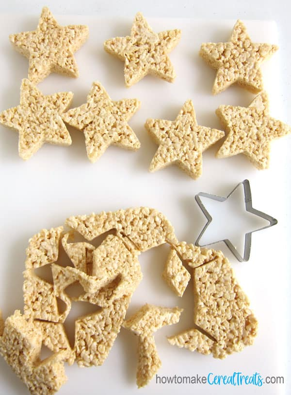 cut the pan of rice krispie treats using a star-shaped cookie cutter