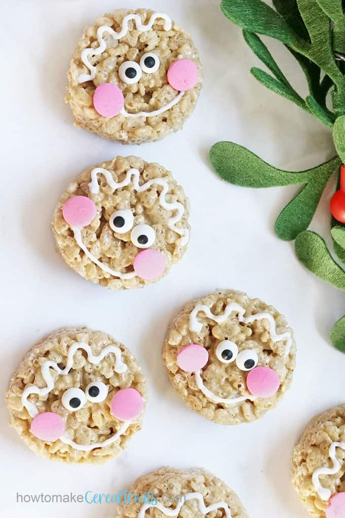 gingerbread Rice Krispie treats decorated as gingerbread man cookies for Christmas