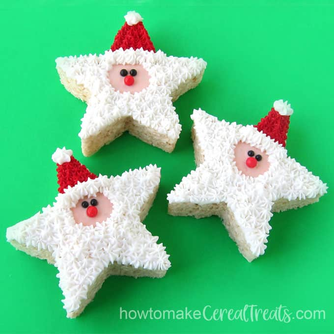 Rice Krispie treat Santa Claus star-shaped cereal treats decorated with frosting and sugar pearls