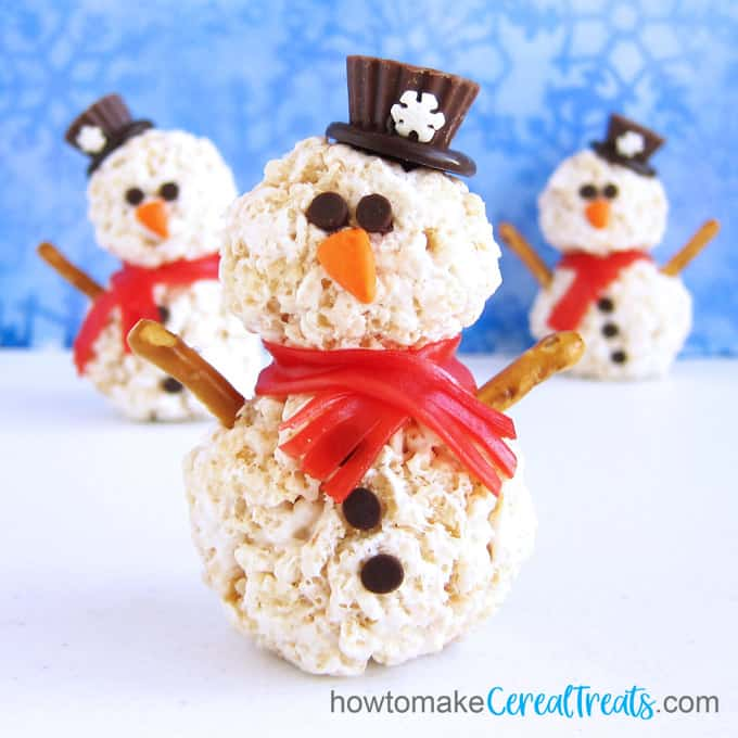 3-D snowmen crafted from rice krispie treats, Reese's Cups, chocolate chips, fruit rolls, chewy orange candies, and pretzel sticks