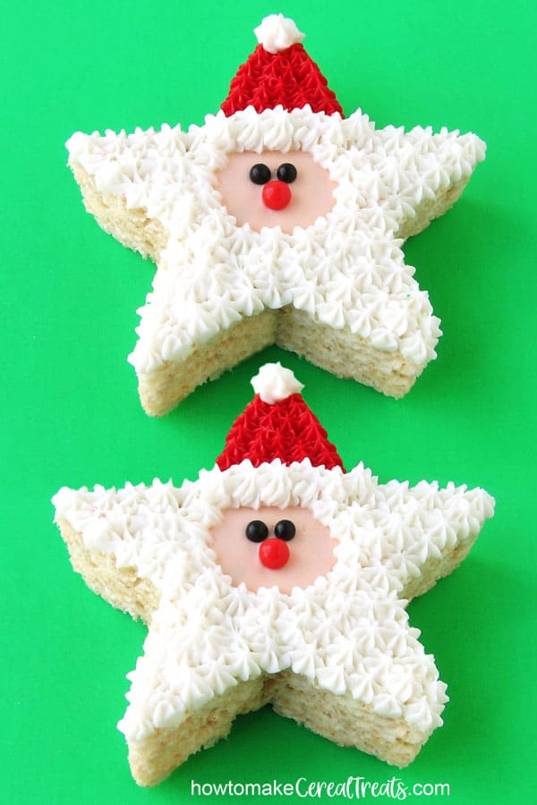 star-shaped Santa Claus Rice Krispie Treats decorated with red frosting hats and white frosting beards