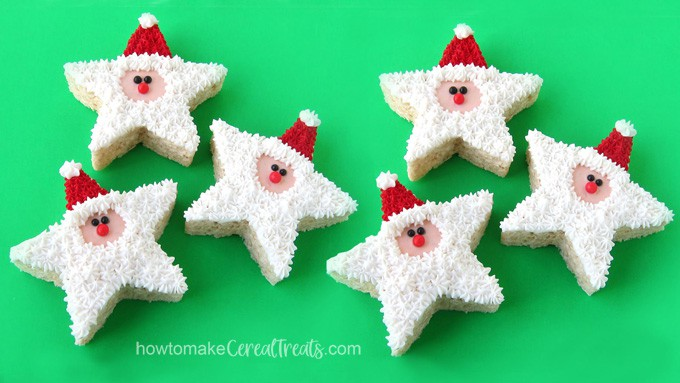 star-shaped Santa Claus Rice Krispie Treats decorated with frosting and sugar pearls