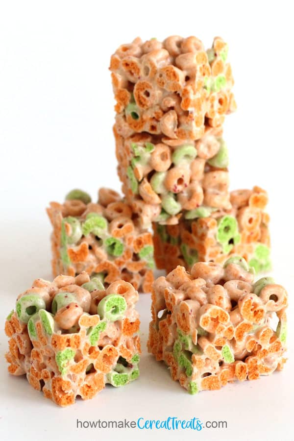 Apple Jacks marshmallow treats made with orange and green Apple Jacks cereal, marshmallows, cinnamon, and butter.
