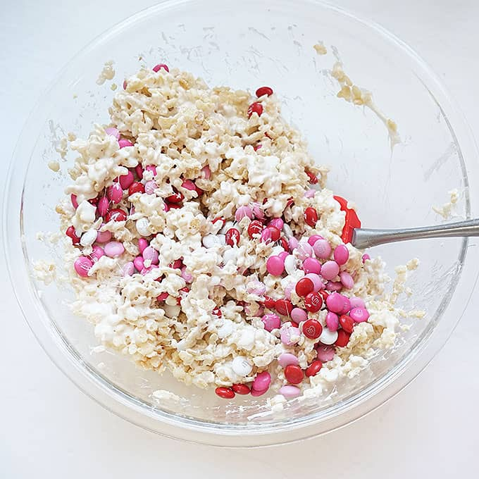 mixing Valentine's Day Rice Krispie Treats