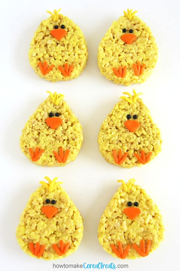 Easter Rice Krispie Treat Chicks decorated with Starburst Fruit Chews beaks and feet and black sugar pearl eyes.