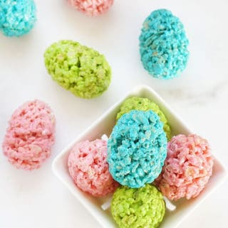 Pink, green, and blue Easter egg Rice Krispie treats shaped with plastic eggs