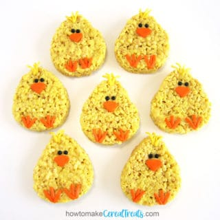 Cute baby chick Rice Krispie Treats with candy feet, beaks, eyes, and feathers.